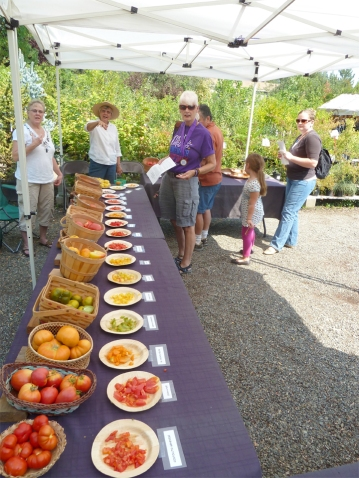 Heirloom tomatoes and happy customers at our summer Tomato Tasting