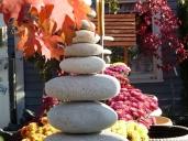 Rock sculptures, garden mums, and fall foliage