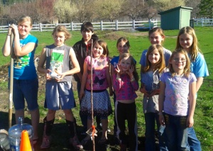 Grass Valley 4-H Club planting a tree for Arbor Day 2014